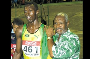 Pablo McNeil and a young Usain Bolt at the World Junior Championships in Kingston, Jamaica
