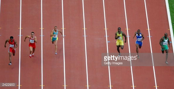 2422900-the-mens-100m-quarter-final-goes-ahead-without-gettyimages