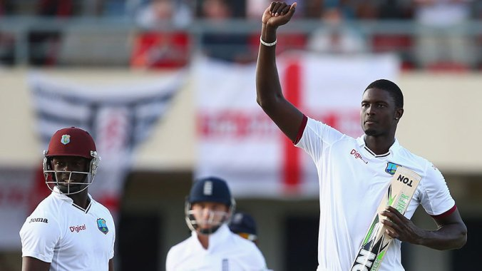 Jason Holder celebrates his maiden first-class and Test century.