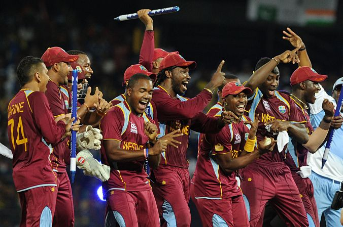 West Indies team celebrates victory during the ICC Twenty20 Cricket World Cup's final match between Sri Lanka and West Indies at the R. Premadasa International Cricket Stadium in Colombo on October 7, 2012. AFP PHOTO/Ishara S. KODIKARA