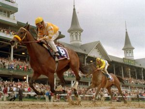 Go For Gin and jockey Chris McCarron win the 1994 Kentucky Derby before a packed house at Churchill Downs