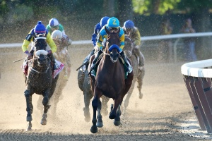 American Pharoah #5, ridden by Victor Espinoza, leads the field out of the fourth turn during the 147th running of the Belmont Stakes at Belmont Park in Elmont, New York.