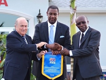 Indicted CONCACAF President Jeffrey Webb (centre) is flanked by indicted former CONCACAF President Jack Warner (right) and FIFA President Sepp Blatter (left)