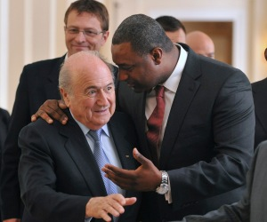 The president of CONCACAF Jeffrey Webb was considered the heir apparent to FIFA President Sepp Blatter, left.  Webb is among the soccer officials that were arrested and detained by Swiss police on Wednesday, May 27, 2015, at the request of U.S. authorities after a raid at Baur au Lac Hotel in Zurich.  (Szilard Koszticsak/MTI via AP, File)