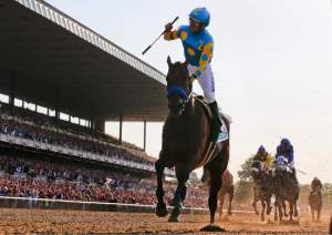 Jockey Espinoza celebrates after winning the Triple Crown onboard American Pharoah