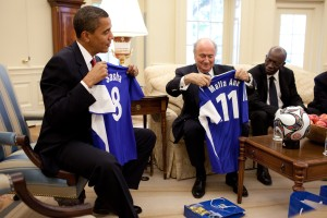 President Barack Obama is presented with soccer jerseys for his daughters, Sasha and Malia by FIFA President Joseph Blatter during a meeting in the Oval Office of the White House on Monday, July 27, 2009. (Official White House Photo by Pete Souza) This official White House photograph is being made available for publication by news organizations and/or for personal use printing by the subject(s) of the photograph. The photograph may not be manipulated in any way or used in materials, advertisements, products, or promotions that in any way suggest approval or endorsement of the President, the First Family, or the White House.