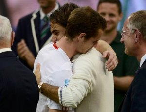 "Roger Federer consoles Andy Murray after Murray lost to him in the Wimbledon final. Murray has said ""its a pity he can't play like (Roger)"""