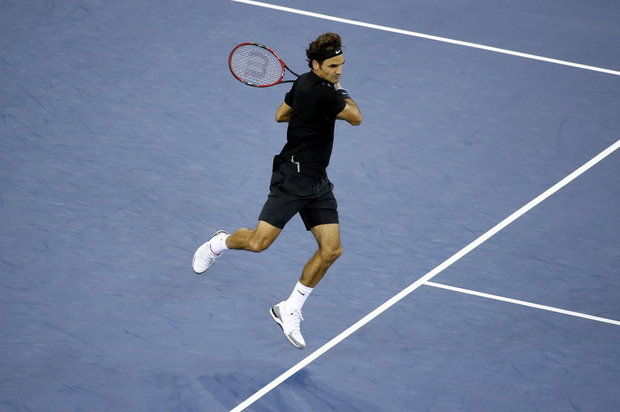 Roger's forehand shot leaves his body mystically poised in mid-flight.
