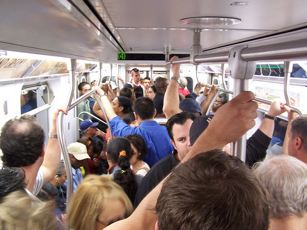 Typical subway travel surrounded by very hard-core Yankees fans