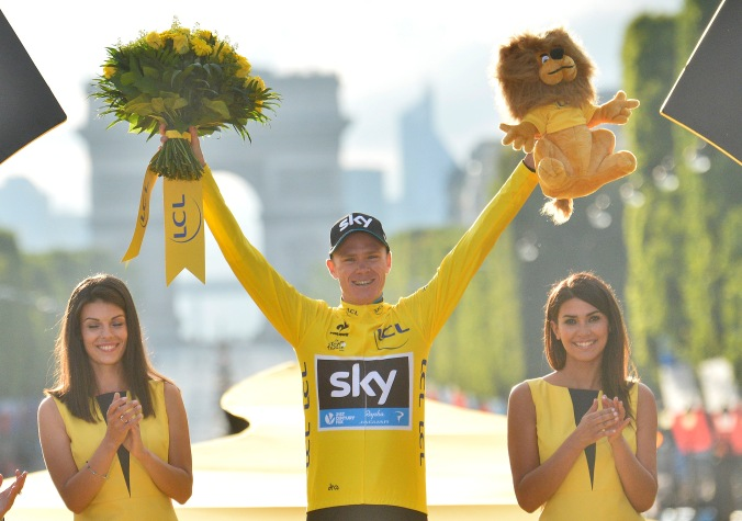Race winner Britain's Chris Froome celebrates as he stands on the podium at the end of the Tour de France cycling race in Paris, France, Sunday, July 26, 2015. (AP Photo/Stephane Mantey, Pool)