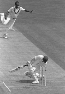 Take that: Andy Lloyd is hit by a Malcolm Marshall delivery during the First Test at Edgbaston in 1984