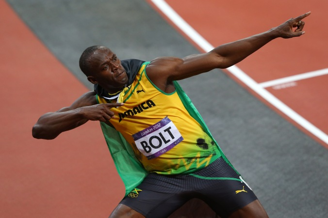 Showman: Usain Bolt celebrates his victory by striking his customary lightning bolt pose in the Olympic Stadium in London (credit: Getty Images)