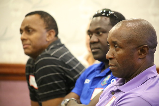 Fellow selectors Courtney Walsh, Courtney Browne and Eldine Baptiste listen to Convenor of Selectors Clive Lloyd speak during a media conference on Sunday, May 24, 2015 at the Accra Beach Hotel. Photo by WICB Media/Philip Spooner