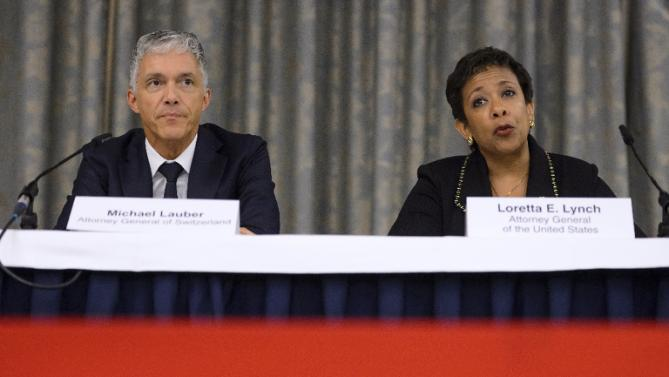 US Attorney General Loretta Lynch and her Swiss counterpart Michael Lauber provide a joint update on the FIFA corruption investigations, during a press conference in Zurich, on September 14, 2015 (AFP Photo/Fabrice Coffrini)