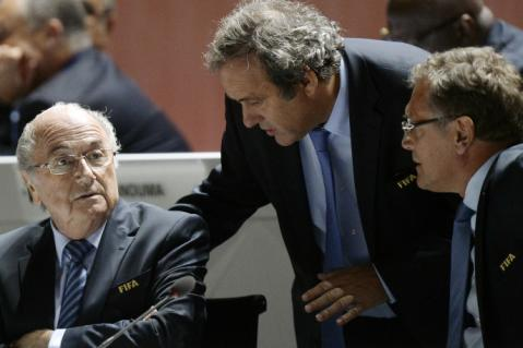 FIFA President Joseph S. Blatter, left, UEFA President Michel Platini, center, and FIFA Secretary General Jerome Valcke, right, are engaged in conversation during the 65th FIFA Congress held at the Hallenstadion in Zurich, Switzerland, Friday, May 29, 2015. (Walter Bieri/Keystone via AP)