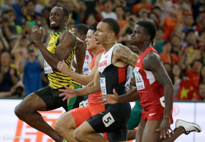 Jamaica's Usain Bolt, left, looks across as he goes all out to win a men's 100m semifinal at the World Athletics Championships at the Bird's Nest stadium in Beijing, Sunday, Aug. 23, 2015. (AP Photo/Lee Jin-man)