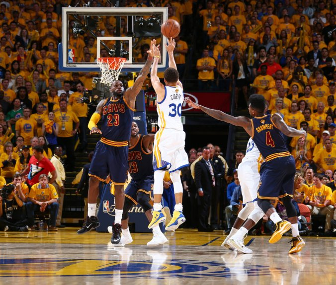 Stephen Curry #30 of the Golden State Warriors shoots against LeBron James #23 of the Cleveland Cavaliers during Game Two of the 2015 NBA Finals on June 7, 2015 at Oracle Arena in Oakland, California. June 08, 2015| Credit: Nathaniel S. Butler