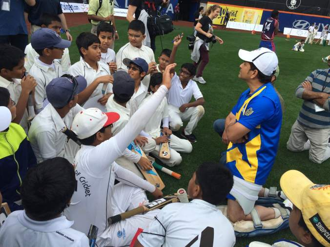 Sachin Tendulkar passes along tips to young cricketers during a clinic at Citi Field, Cricket All-Stars, Queens, New York, November 6, 2015 ©Siddhartha Vaidyanathan