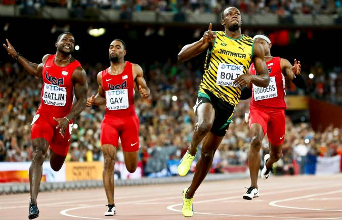 Usain Bolt beats Justin Gatlin and Tyson Gay in the men's 100m final during the 15th IAAF World Championships at the National Stadium in Beijing, China August 23, 2015. REUTERS/Lucy Nicholson