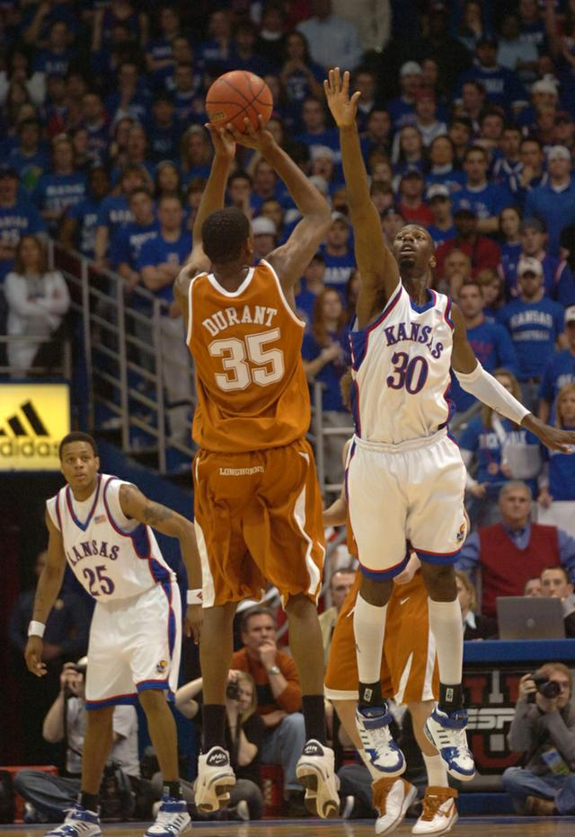 Kansas' Julian Wright attempts to block the shot of Texas' Kevin Durant on Saturday at Allen Fieldhouse. Durant finished with 32 points. (Photo: Thad Allender)