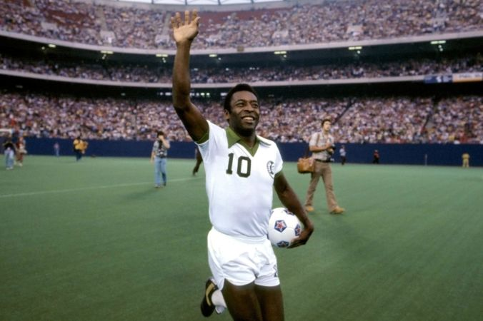 Pele playing football (soccer) in the US before thousands of spectators