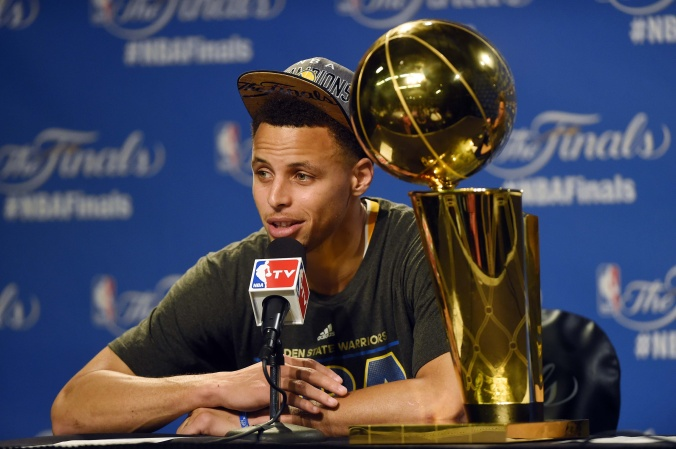 Stephen Curry and the Golden State Warriors wins the 2015 NBA Championship. (Courtesy of USA Today Sports)