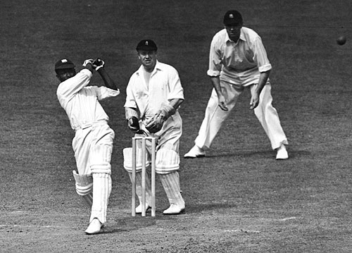 West Indies cricketer George Headley (1909 - 1983) batting against England in the Test Match at The Oval, London, 1939. At the wicket is Arthur Wood (1898 - 1973), and at the slip is Wally Hammond (1903 - 1965) (Photo by Central Press/Hulton Archive/Getty Images)