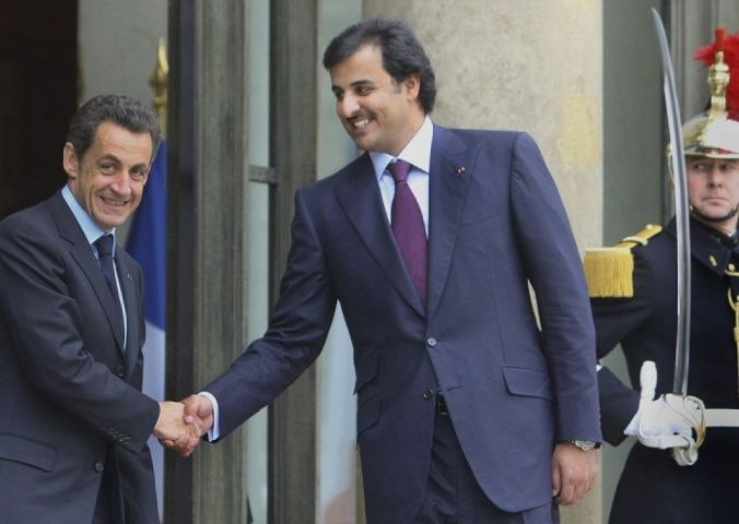 Nicolas Sarkozy (left) and Tamim ben Hamad Al Thani along with Platini changed the plans of awarding the 2022 World Cup to the USA (AP Photo)