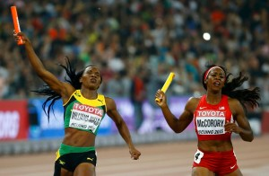Novlene Williams-Mills of Jamiaca (L) and Francena McCorory of the U.S. compete as they cross the finish line in the women's 4 x 400 metres relay final during the 15th IAAF World Championships at the National Stadium in Beijing, China August 30, 2015. (Photo by Damir Sagolj/Reuters)