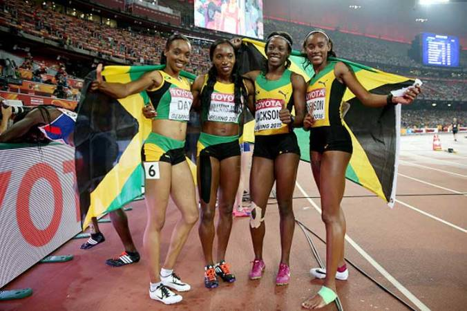Shericka Jackson of Jamaica, Stephenie Ann McPherson of Jamaica, Novlene Williams-Mills of Jamaica and Christine Day of Jamaica celebrate after winning gold in the Women's 4x400 Relay Final during day nine of the 15th IAAF World Athletics Championships Beijing 2015 at Beijing National Stadium on August 30, 2015 in Beijing, China.
