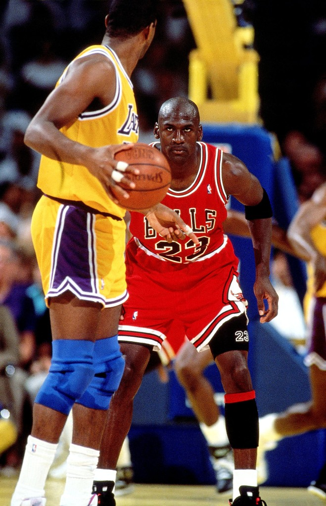 MJ vs MJ: Magic Johnson and Michael Jordan go at it. (Photo credit Andrew D. Bernstein /NBAE /Getty Images)