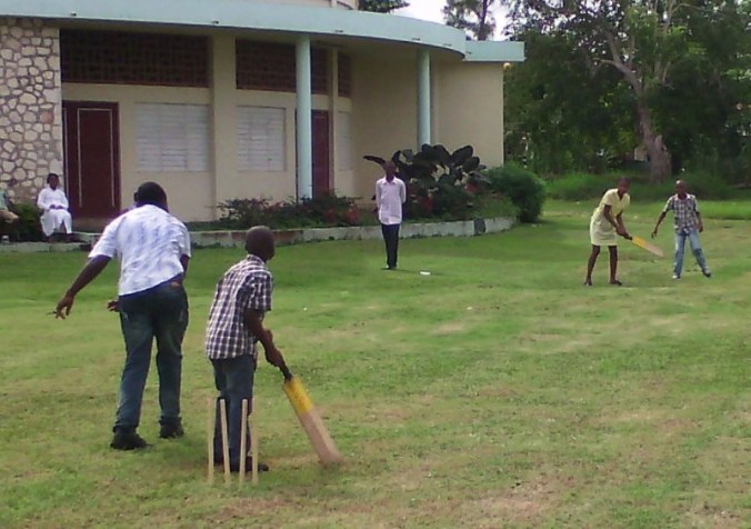 Kids playing cricket after Sunday Mass service at the Falmouth Roman Catholic Church