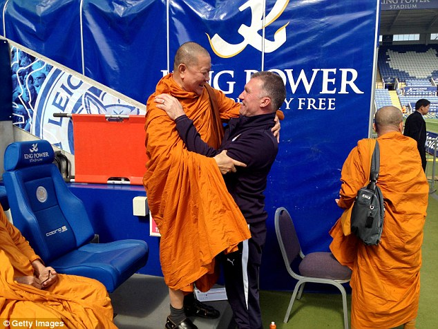 Foxes former manager Nigel Pearson, embraces a monk at the King Power Stadium last season. Getty Images