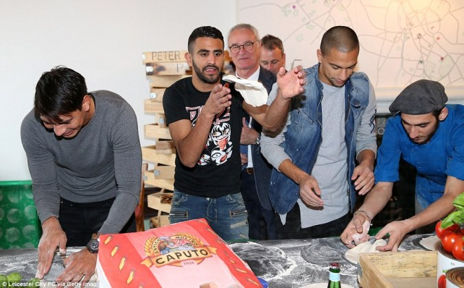 Leicester forward and PFA player of the year Riyad Mahrez (centre) flips some dough in the air as he tries his hand at making pizza. Leicester City Images via Getty Images