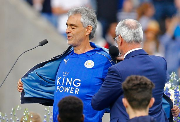 Andrea Bocelli takes off his top to reveal a Leicester City shirt to the delight of Leicester fans. Reuters / Darren Staples