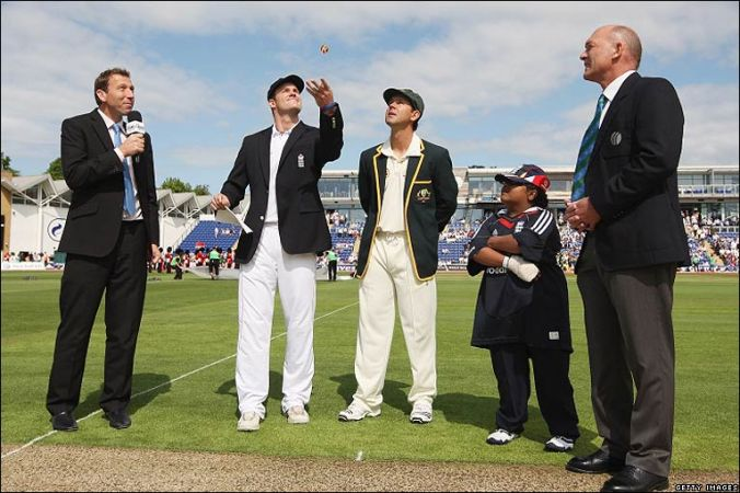 England Captain Andrew Strauss tosses the coin while Australian Captain Ricky Ponting calls ahead of a first Test in 2009.
