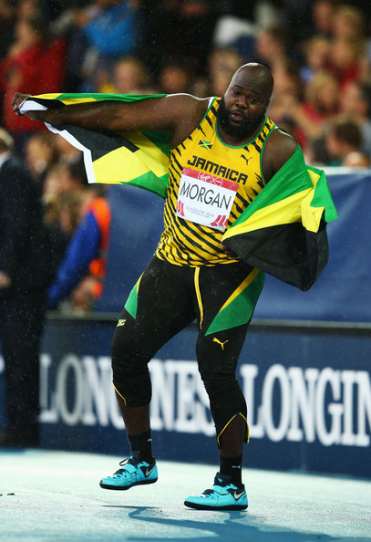 Jason Morgan of Jamaica celebrates winning bronze in the Men's Discus Final at the Glasgow 2014 Commonwealth Games. (Photo credit: Richard Heathcote/Getty Images Europe)