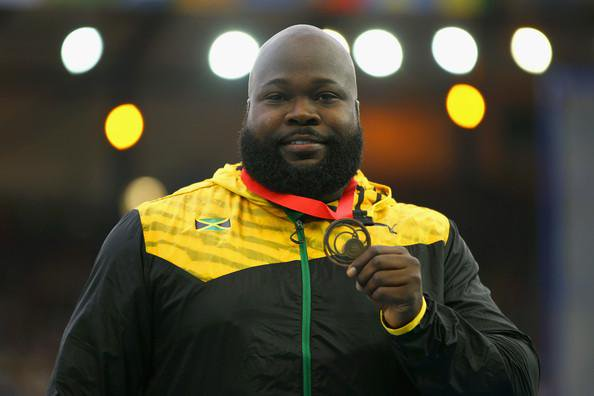 Bronze medallist Jason Morgan of Jamaica on the podium during the medal ceremony for the Men's Discus Throw at Hampden Park during day eight of the Glasgow 2014 Commonwealth Games on July 31, 2014 in Glasgow, United Kingdom. (Photo credit: Richard Heathcote/Getty Images)