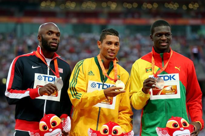 BEIJING, CHINA - AUGUST 27: (L-R) Silver medalist Lashawn Merritt of the United States, gold medalist Wayde Van Niekerk of South Africa and bronze medalist Kirani James of Grenada pose on the podium during the medal ceremony for the Men's 400 metres final during day six of the 15th IAAF World Athletics Championships Beijing 2015 at Beijing National Stadium on August 27, 2015 in Beijing, China. (Photo by Alexander Hassenstein/Getty Images for IAAF)