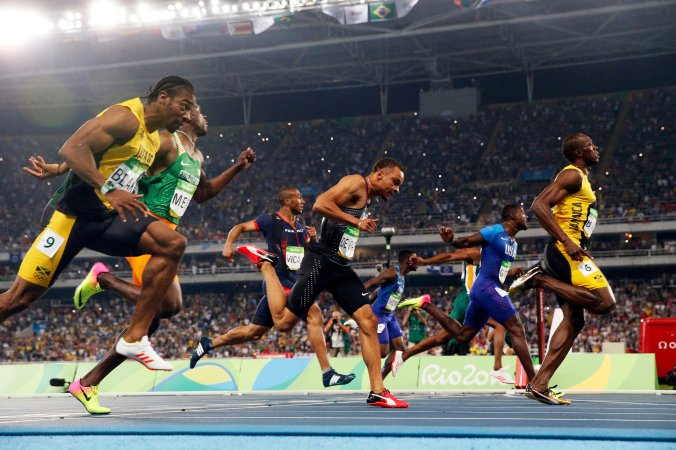 Usain Bolt of Jamaica, right, wins his third consecutive 100-meter Olympic title in Rio de Janeiro. (Photo credit Doug Mills/The New York Times)