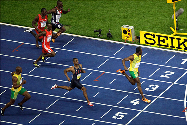 Usain Bolt, right, crossed the finish line in a world-record 9.58s ahead of American Tyson Gay, second from right, and Jamaica's Asafa Powell, foreground left in the men's 100m final at the 2009 Berlin World Championships . (Photo credit: David Azia/Associated Press)