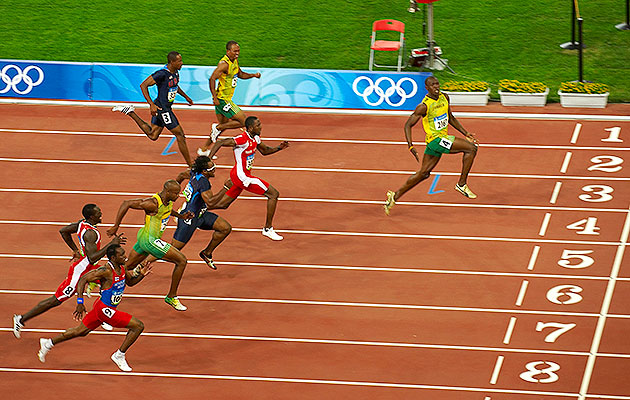 Usain Bolt crushed the field in the 2008 Beijing Olympics, setting a then-world record of 9.69 seconds in the process. (Photo credit: John Biever)