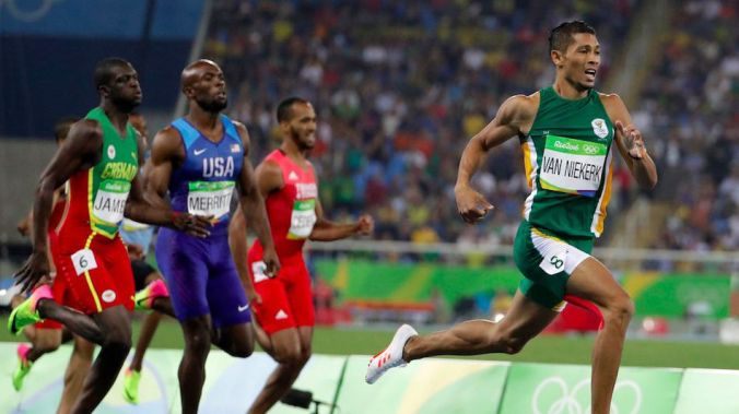 South Africa's Wayde Van Niekerk takes the lead in the men's 400-metre final at the 2016 Summer Olympics in Rio de Janeiro, Brazil. (Photo credit: AP Photo/David Goldman