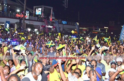 Jamaicans in Half-Way-Tree square celebrate the successes in the recent Rio Olympics. (Kenyon Hemans)