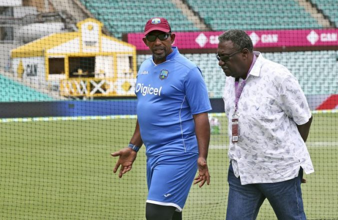 West Indies coach Phil Simmons, left, chats with former player Clive Lloyd before team training ahead of their test match against Australia in Sydney, Saturday, Jan. 2, 2016. The test match will begin Sunday. (AP Photo/Rob Griffith)