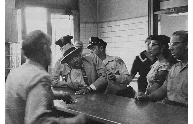 Martin Luther King Jr. is arrested for loitering outside a courtroom where his friend Ralph Abernathy is appearing for a trial, Montgomery, Alabama, 1958. (Photo credit: CHARLES MOORE/Courtesy of Steven Kasher Gallery, New York)