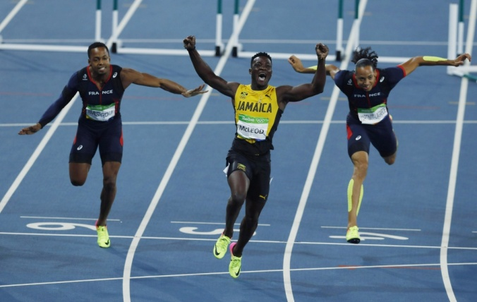 An ecstatic Omar McLeod celebrates after win gold at the 2016 Rio Olympics. (Photo credit: Xinhua News Agency)