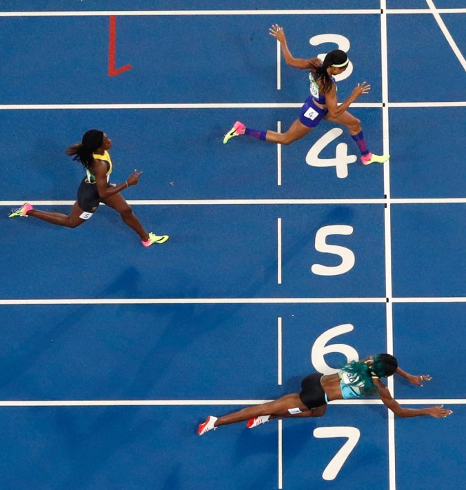 Shaunae Miller of the Bahamas threw herself across the finish line to win gold in the 400-meter final on Monday. She finished in 49.44 seconds, defeating Allyson Felix of the United States (49.51). (Photo credit: Fabrizio Bensch/Reuters)