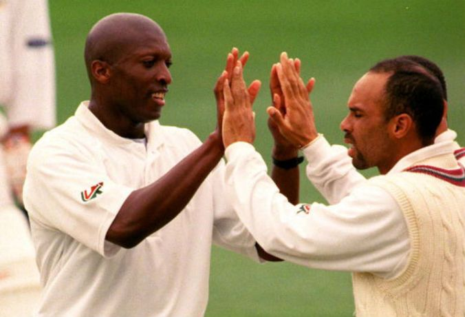 Franklyn Rose celebrates a wicket with Jimmy Adams, December 13, 1999. ©Getty Images