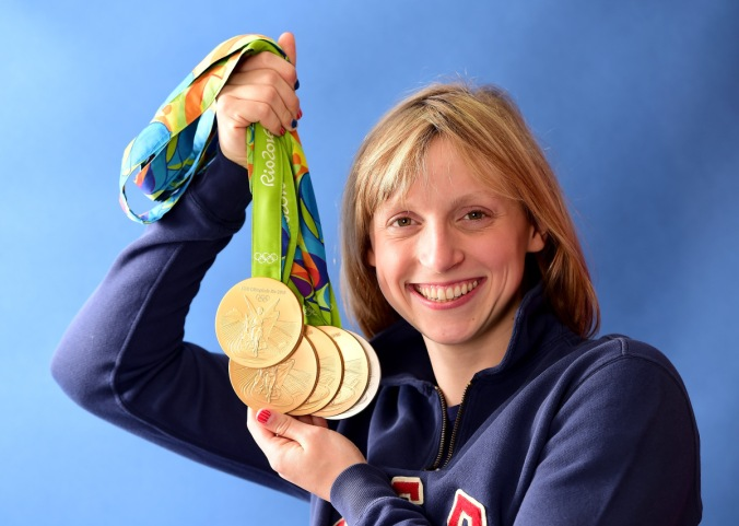 Swimmer, Katie Ledecky of the United States poses with her five medals from the 2016 Rio Olympics. (Photo credit: Harry How/Getty Images)